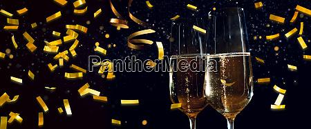 champagne glasses and golden confetti