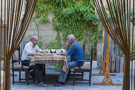 people having tea in an ancient