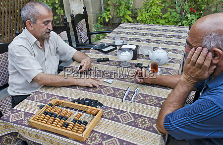 people having tea and playing game