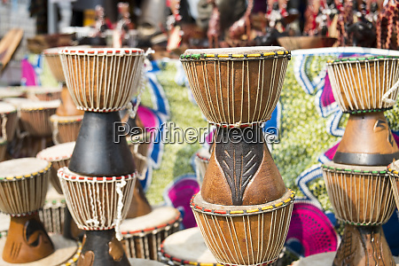 djembe drums stacked up at an