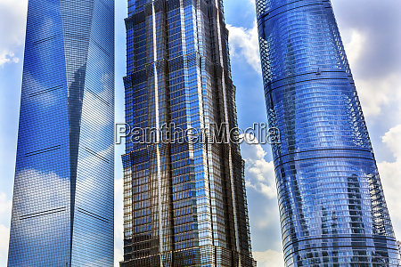 three skyscrapers reflection making patterns liujiashui