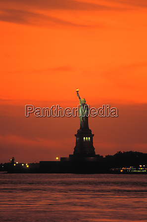 statue of liberty sunset new york