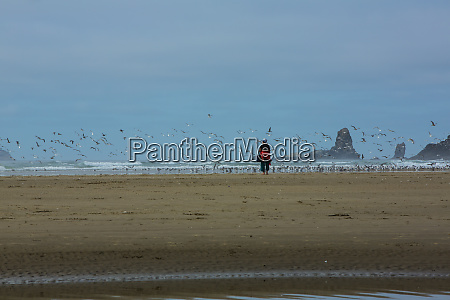 cannon beach oregon woman looking at