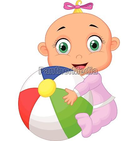 baby maedchen haelt bunten ball