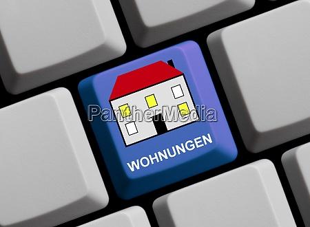 symbol auf computertastatur wohnungen in deutscher