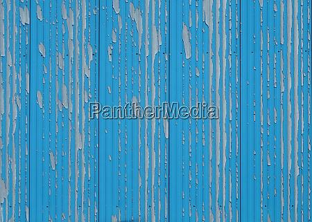 verwitterte hellblaue farbe auf metallwand