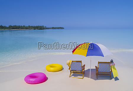 beach chairs and umbrella on remote