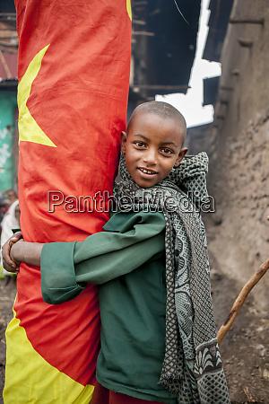 kid with ethiopian flag lalibela ethiopia