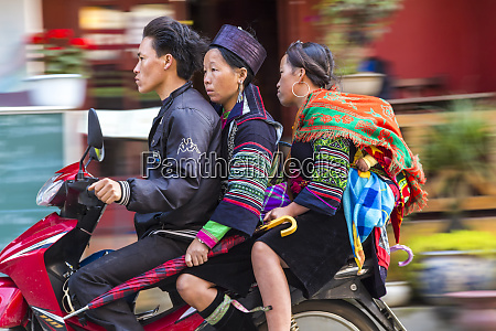 black hmong tribes women on scooter