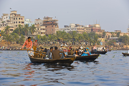 rowing river taxi in the busy