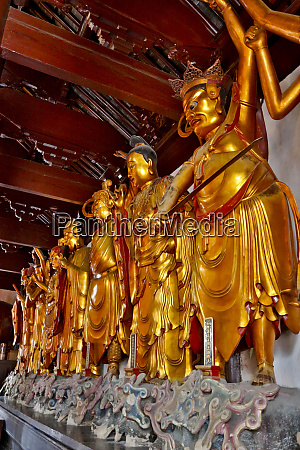 golden and colorful buddha at the