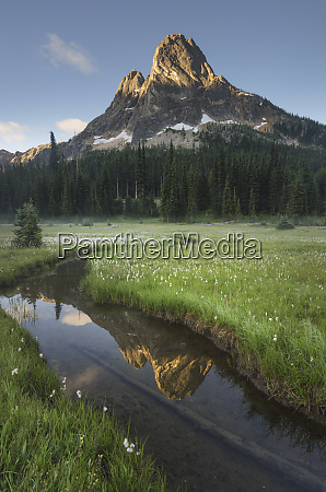 liberty bell mountain reflected in waters
