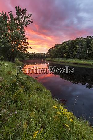 dawn on the mattawamkeag river flowing