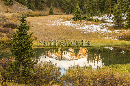 usa colorado red mountain reflected in