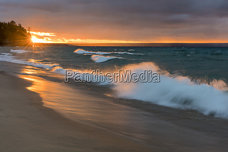 dramatic sunset light along miners beach