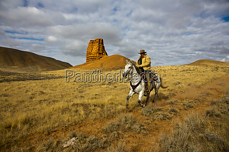 usa wyoming shell cowboy riding by