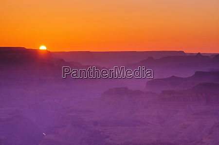 sunset over the grand canyon grand