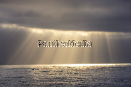 rays emit from the clouds over