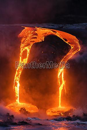 lava flow entering the ocean at
