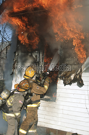 firefighters extinguishing house fire kinmundy alma