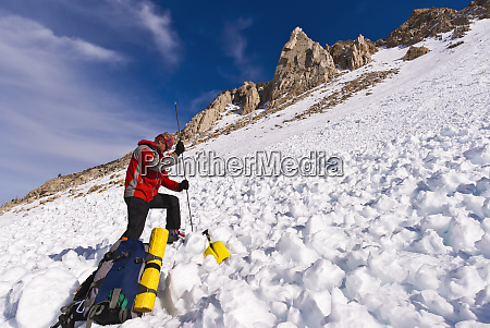 backcountry skier using avalanche gear inyo