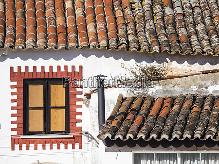 portugal obidos unusual decorated window and