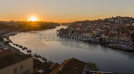 sunset over rio douro left vila