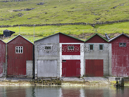 boat sheds in the harbor of