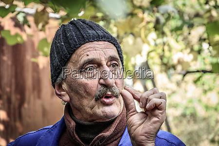 viscri romania local villager explaining how