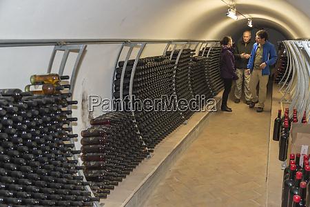 italy sardinia mamoiada wine bottles stacked