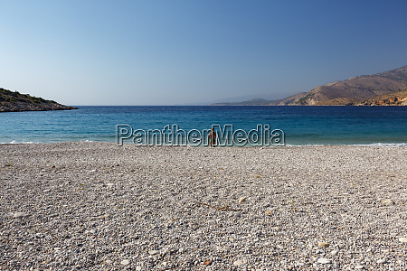 woman at trahili beach chios island