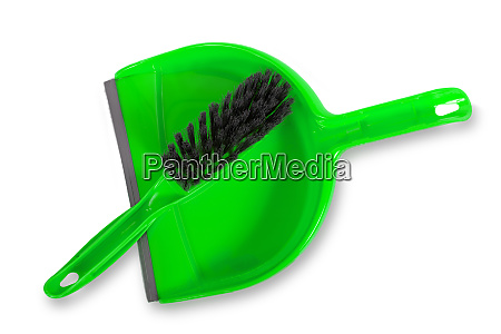 green dustpan and brush isolated on