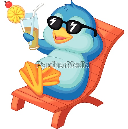 netter pinguin sitzt auf strandkorb