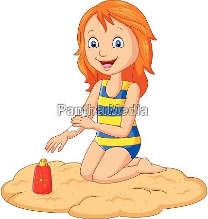 little girl in a swimsuit applying