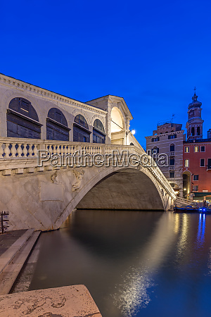 illuminated rialto bridge in venice at