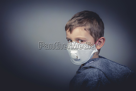 boy wears a protective medical mask