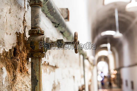 rusty water pipes of old prison