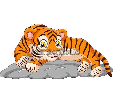 cartoon tiger legt sich auf stein