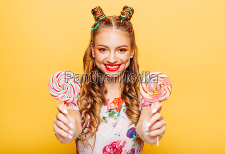smiling lady holding two huge colorful