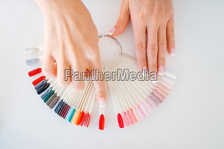 female hands and colorful nail varnish