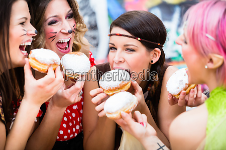 girls at german fasching carnival eating