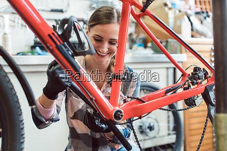 bike mechanic working on gears of