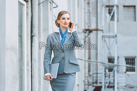 business woman using her phone in