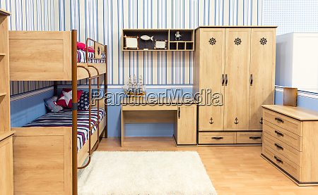 bright bedroom with a bed cupboard