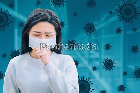 gestresste frau traegt schutzmaske gegen grippevirus