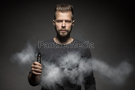 vaping e liquid from an electronic
