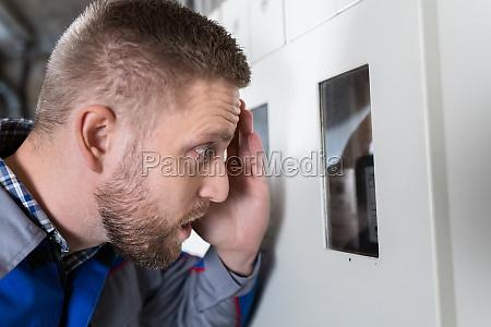 shocked man looking at meter