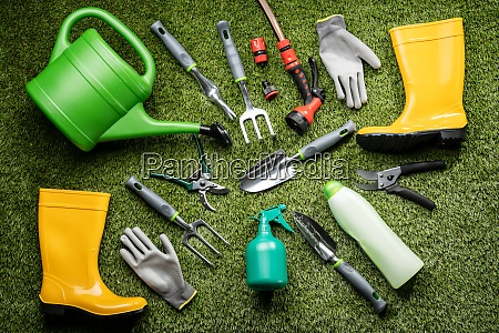 various gardening tools laying on grass