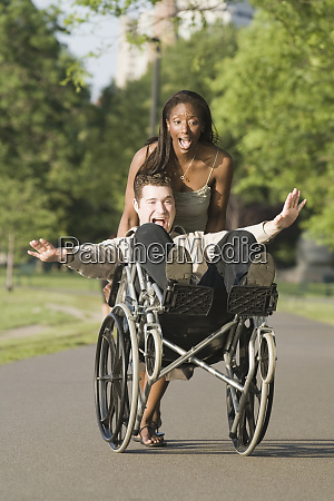 mid adult woman pushing a mid