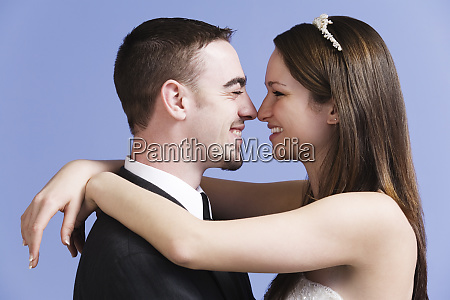 side view of bride and groom